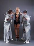 Trio of go-go dancers in erotic costumes Stock Photography