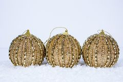 Trio of Gold Ornaments royalty free stock image