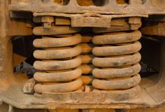 A trio of heavy-duty springs on the side of a freight train Stock Images