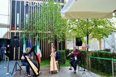A trio of Irish musicians are playing at the EXPO Milano 2015. Stock Image