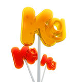 Trio of kilo symbol lollipops Stock Photo