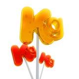 Trio of kilo symbol lollipops. Trio of Lollipops shaped like the kilo symbol Stock Photo