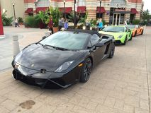 The trio. Lamborghini trio. Classical black green and orange royalty free stock images