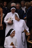 Trio of nuns exit basilica Stock Images