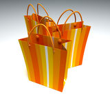 Trio of orange striped shopping bags. 3D rendering of a trio of good quality orange striped shopping bags against a white background Royalty Free Stock Photo