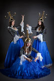 Trio of oriental dancers with candelabras Royalty Free Stock Images