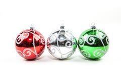 Trio of Ornament. A trio of Christmas ornaments in a row Stock Photo