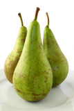 Trio Of Pears. A trio of ripe Conference pears arranged on a plate Stock Images