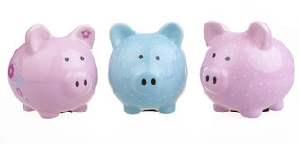 A trio of piggy banks. Stock Photo