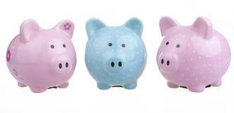 A trio of piggy banks. Stock Photo