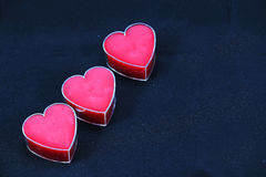 A Trio of Pink  Hearts on a Black Background. Stock Image