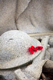 Poppies on a War Memorial. A trio of poppies are laid on a war memorial Royalty Free Stock Image