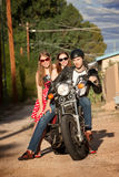 Trio posing on motorcycle Stock Image