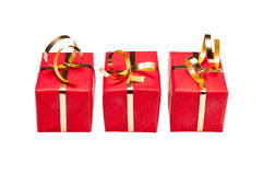 Trio of Red and Gold Xmas Gift Boxes Royalty Free Stock Photo