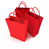 Trio of red shopping bags. 3D rendering of three red shopping bags against a white background Royalty Free Stock Photos