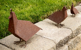 A trio of rusted metal birds Royalty Free Stock Images