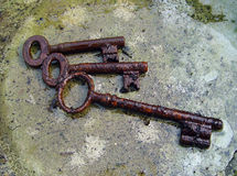 Trio of rusty keys Stock Images