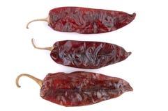 Trio secco dei peperoni di peperoncino rosso Fotografia Stock