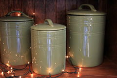 Trio of stoneware canisters on wood shelf Royalty Free Stock Images