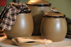 Trio of stoneware pots and napkin Stock Photography
