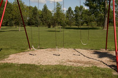 Trio of Swings Royalty Free Stock Image