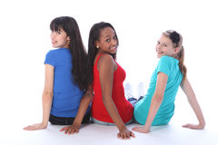 Trio teenage girls mixed races looking backwards Royalty Free Stock Photos