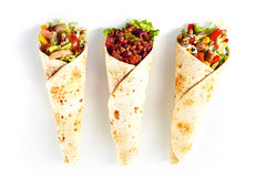 Trio of Tex Mex Fajita Wraps with Various Fillings. High Angle Still Life of Trio of Tex Mex Fajita Wraps Wrapped in Grilled Flour Tortillas and Filled with royalty free stock photo