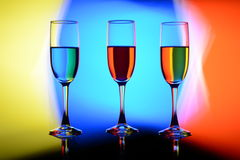 Trio. Three bright multi-colored glasses Royalty Free Stock Photo
