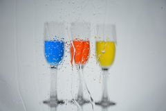 Trio. Three bright multi-colored glasses Stock Image