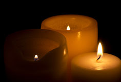 Trio Of Three Warm Candles With Flames Royalty Free Stock Images