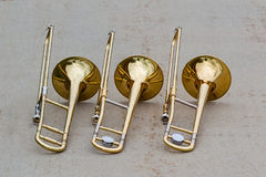 Trio of trombones taking a quick break Royalty Free Stock Images