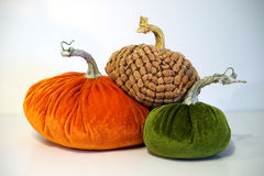 Trio of velvet pumpkins Royalty Free Stock Photos
