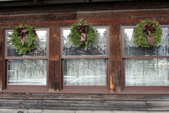Trio of windows with holiday wreaths Stock Image