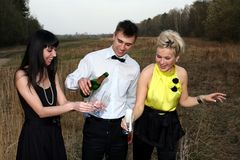 Trio with wine Royalty Free Stock Image