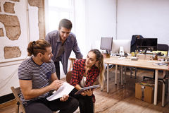 Trio of young business people meeting Stock Images