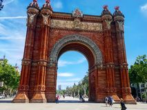 Triomph arch of Barcelona. Incredible view of the Arch and the way from it to the Ciutadella park with palms on every side Stock Photos