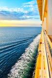 Trip across the sea at sunset stock photos