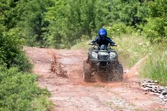 A trip on the ATV on the red road. A trip on the ATV on the red road stock images