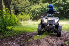 A trip on the ATV on the red road. A trip on the ATV on the red road royalty free stock image