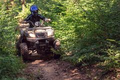 A trip on the ATV on the red road royalty free stock images