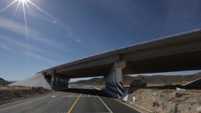 A trip below vehicular bridge stock video