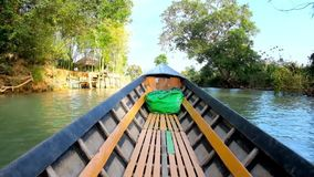 Trip on canoe, Inle Lake, Myanmar. INLE LAKE, MYANMAR - FEBRUARY 18, 2018: The wooden canoe boat floats along the Indein creek with village houses, agricultural stock video