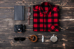 Trip concept - items of men's clothing and accessories. On the desk stock photography