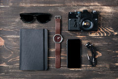 Trip concept - items of men's clothing and accessories. On the desk stock photo