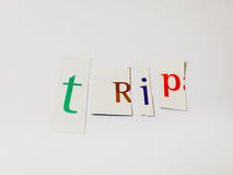 Trip - Cutout Words Collage Of Mixed Magazine Letters with White Background. Caption composed with letters torn from magazines with White Background Stock Photography