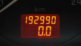 Trip or Distance meter from an automobile instruments panel being reset to zero. Inside the car dashboard speedometer. The Odometer in kilometers is also shown stock footage