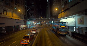 Trip in double-decker tram. HONG KONG - NOVEMBER 10, 2015: Journey in second level of double-decker tram along street at night. In 2014 Hong Kong Tramways stock footage