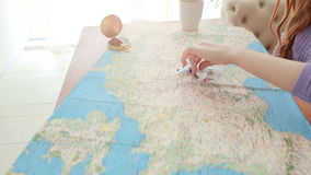 Trip dreams. Playing with map and toy airplane. Woman hand. Video footage stock footage