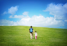 On trip with father. Father and child walking in the hills Royalty Free Stock Photo