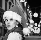 Surprised woman at Christmas in Florence, Italy looking aside. Trip full of inspiration at Christmas time in Florence. Closeup on surprised modern woman in Royalty Free Stock Image